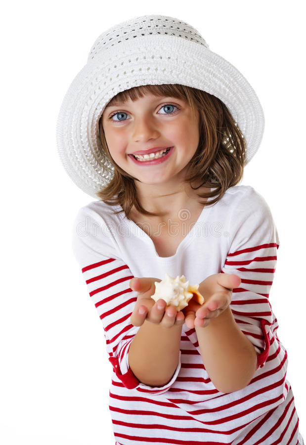 Little girl holding a shell stock photo