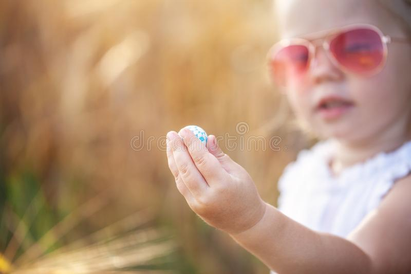 Little girl holding a small ball in her hand royalty free stock photo