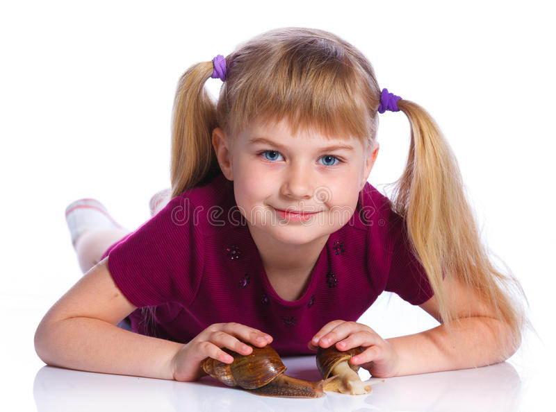 Little girl holding snails in hands. Portrait of little girl holding snails in hands. Isolated on the white background royalty free stock photos