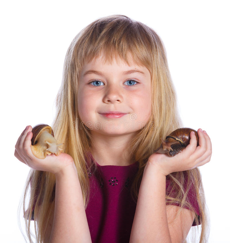 Little girl holding snails in hands. Portrait of little girl holding snails in hands. Isolated on the white background royalty free stock photography