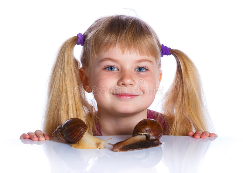 Little girl holding snails in hands. Portrait of little girl holding snails in hands. Isolated on the white background royalty free stock images