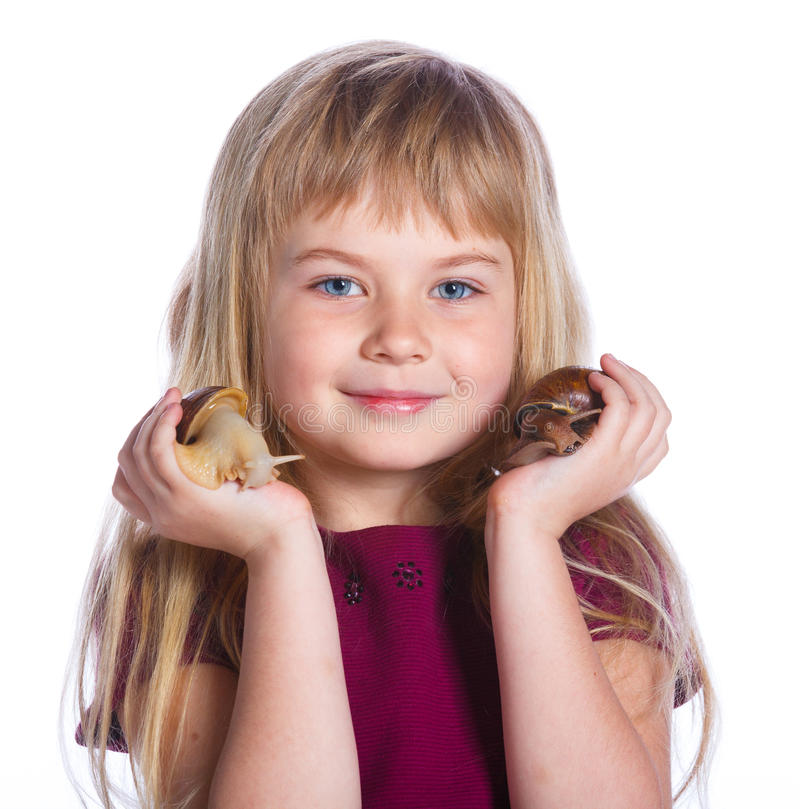 Little girl holding snails in hands. Portrait of little girl holding snails in hands. Isolated on the white background stock photo