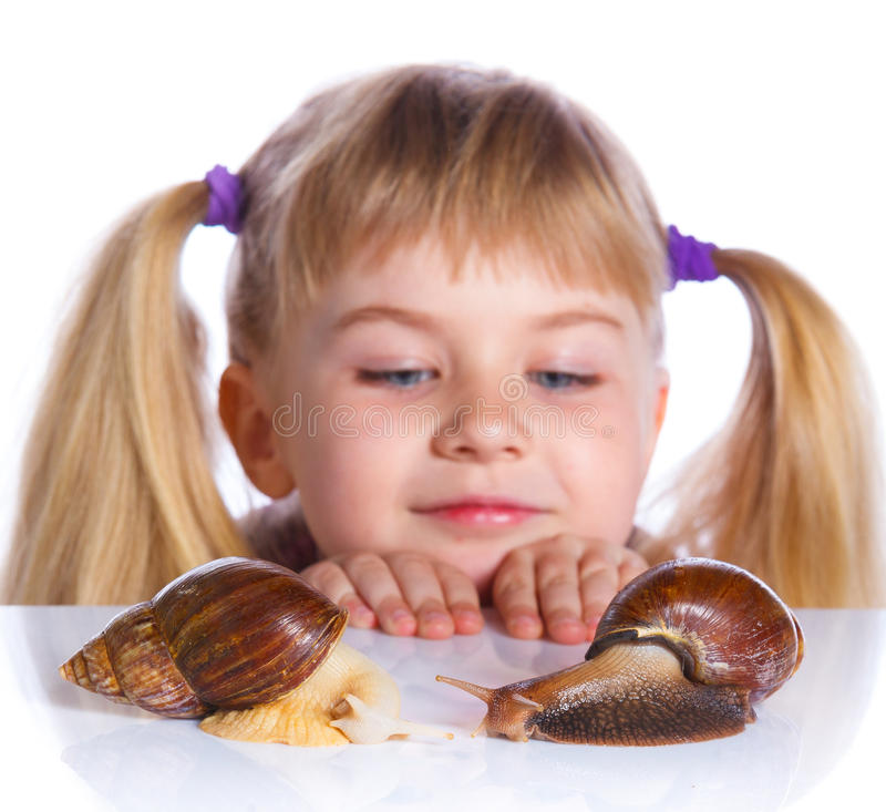 Little girl holding snails in hands. Portrait of little girl with snails. Isolated on the white background royalty free stock photos