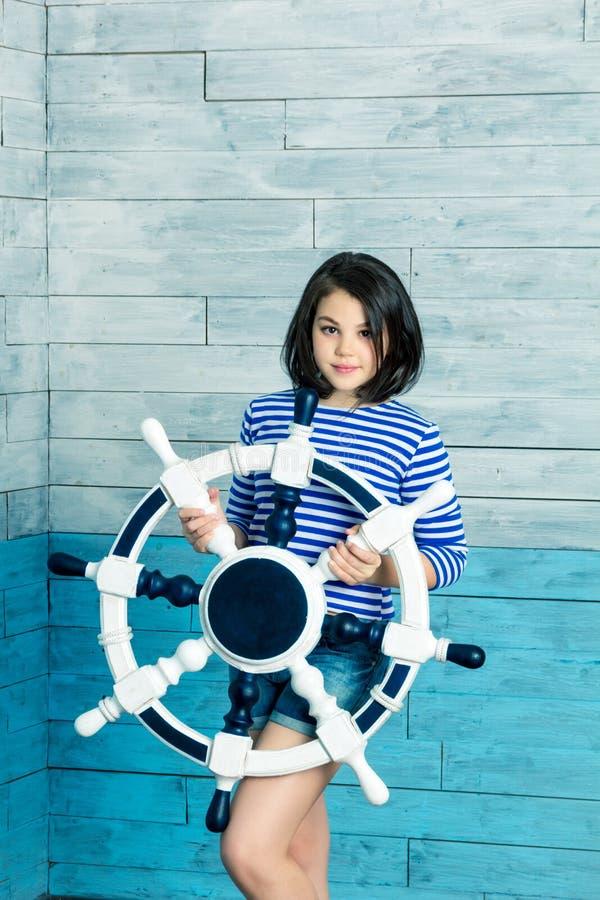 Little girl holding a steering wheel stock images