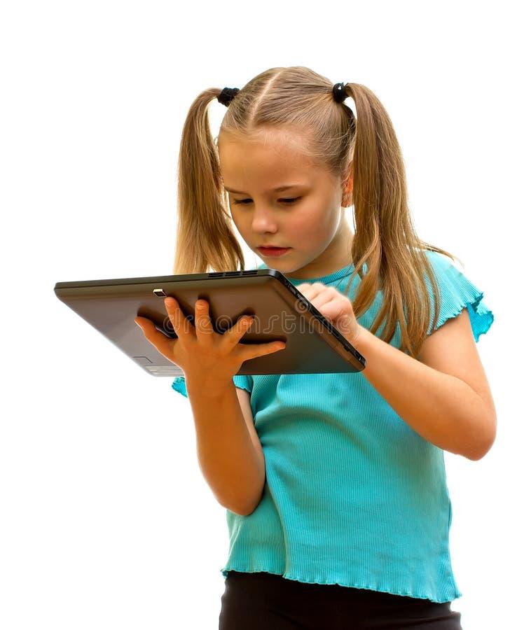 Little girl holding Tablet PC. stock photos