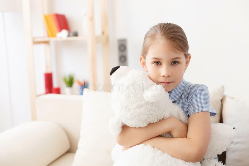 Little girl holding teddy bear royalty free stock photography