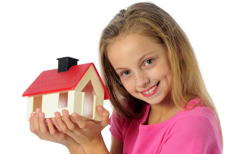 Little girl holding toy house. Portrait of little girl with toy house isolated on white royalty free stock photo