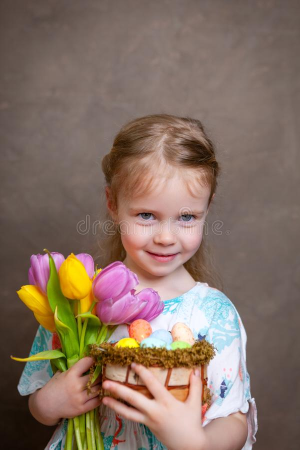 Little girl holding tulips stock photo