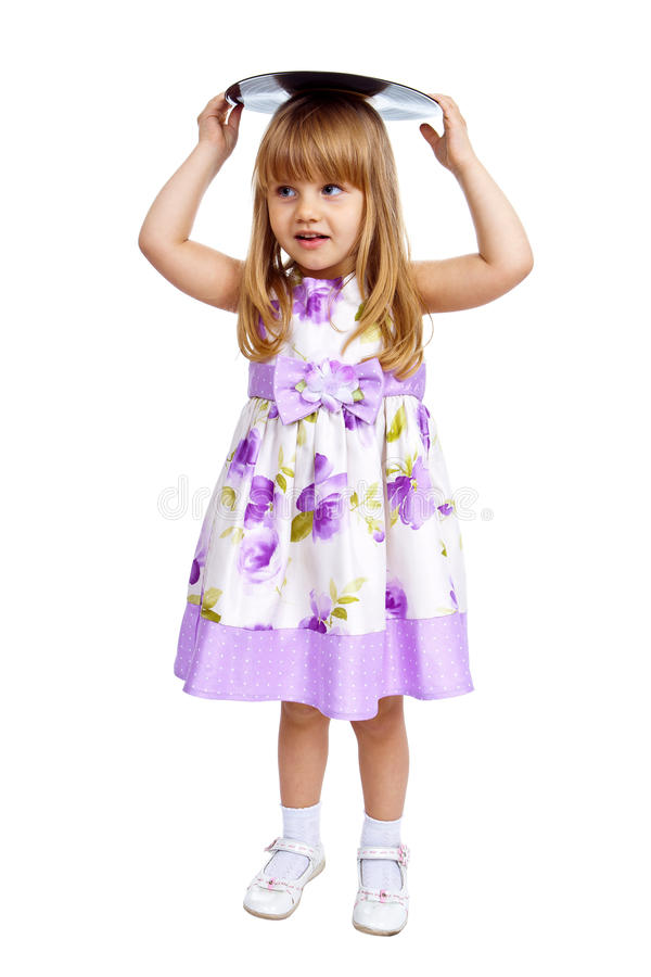 Little girl holding vinyl plate. On her head isolated against white background royalty free stock photos