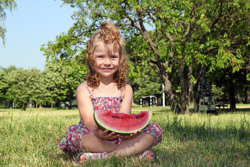 Download Little Girl Holding Watermelon Stock Photo - Image: 25570874