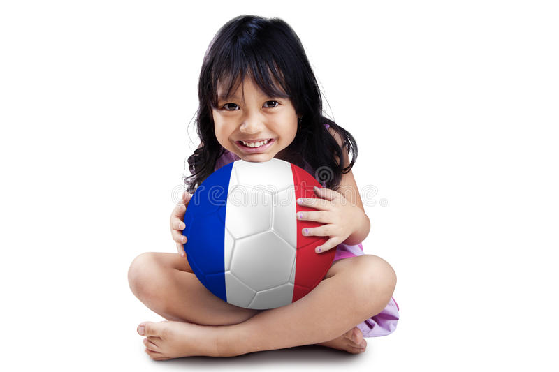Little girl holds ball with flag of France royalty free stock image