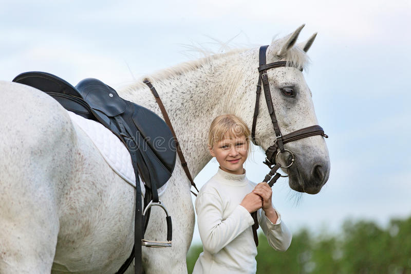 Little girl with a horse. royalty free stock images
