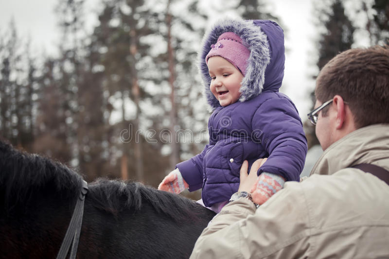 Little girl on horse royalty free stock photography