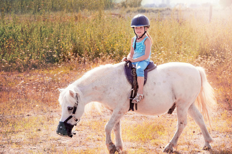 Little girl on the horse. royalty free stock photos