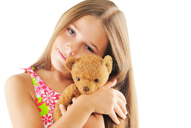 Little girl hugging bear toy. On white background royalty free stock photo