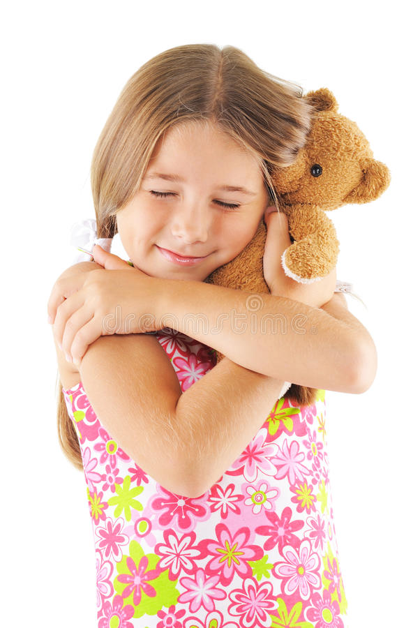 Little girl hugging bear toy. On white background stock photography