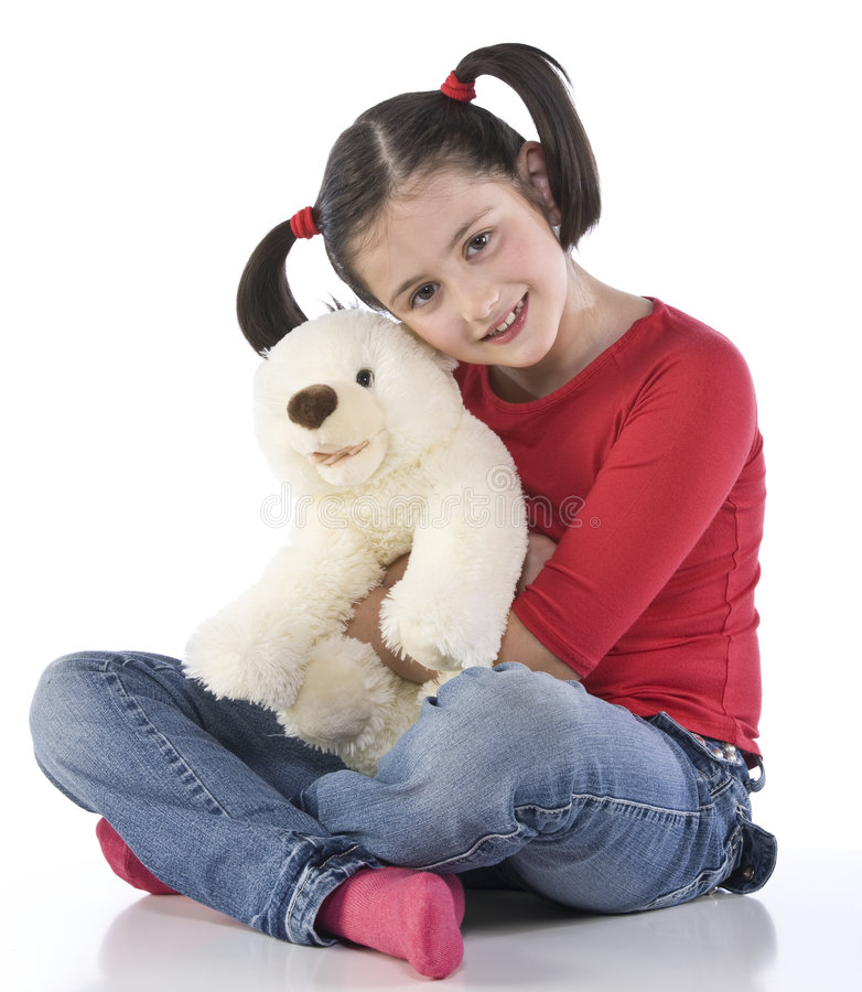 Little girl is hugging big teddy bear. On a white background stock images