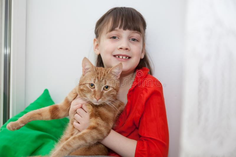 Little  girl    hugging with cat. Portrait of  little  girl    hugging with cat at home stock photo