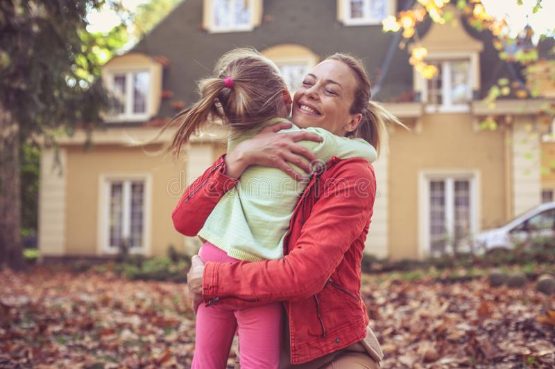 Little girl hugging her Mother, share love. royalty free stock photo