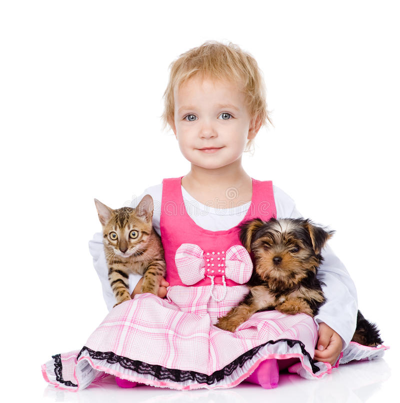Little girl hugging a kitten and a puppy stock images