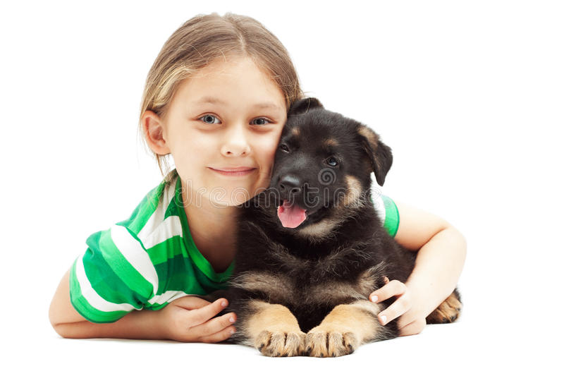 Little girl hugging puppy on white background. Little girl hugging a German Shepherd puppy on white background stock photos