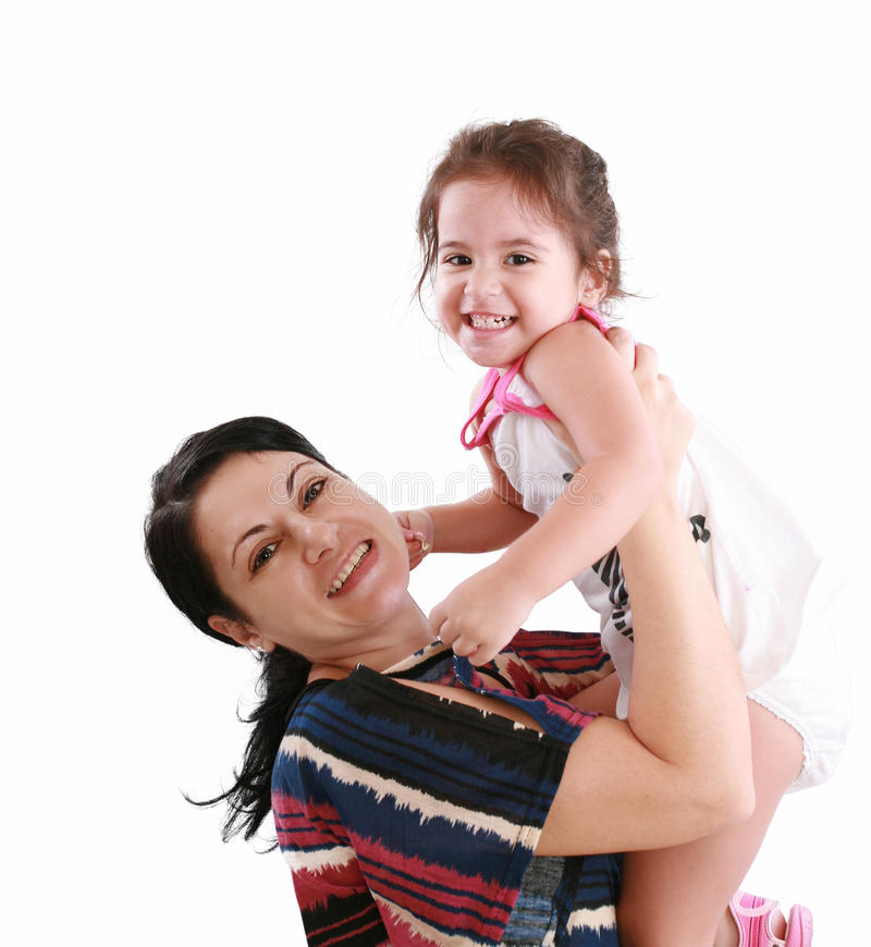 Little girl hugging to mother royalty free stock images
