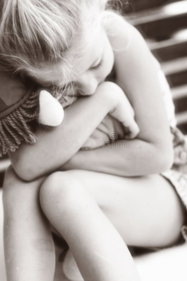 Little girl hugging toy soft focus. A little girl hugging a toy royalty free stock photo