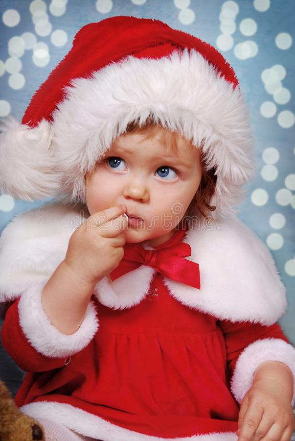 Free Little Girl In Santa Hat On Christmas Time Stock Images - 134204524