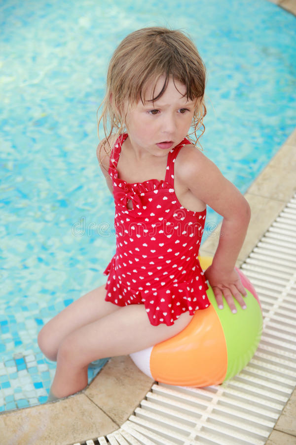 Free Little Girl In The Water Pool With A Ball Stock Photography - 32048792