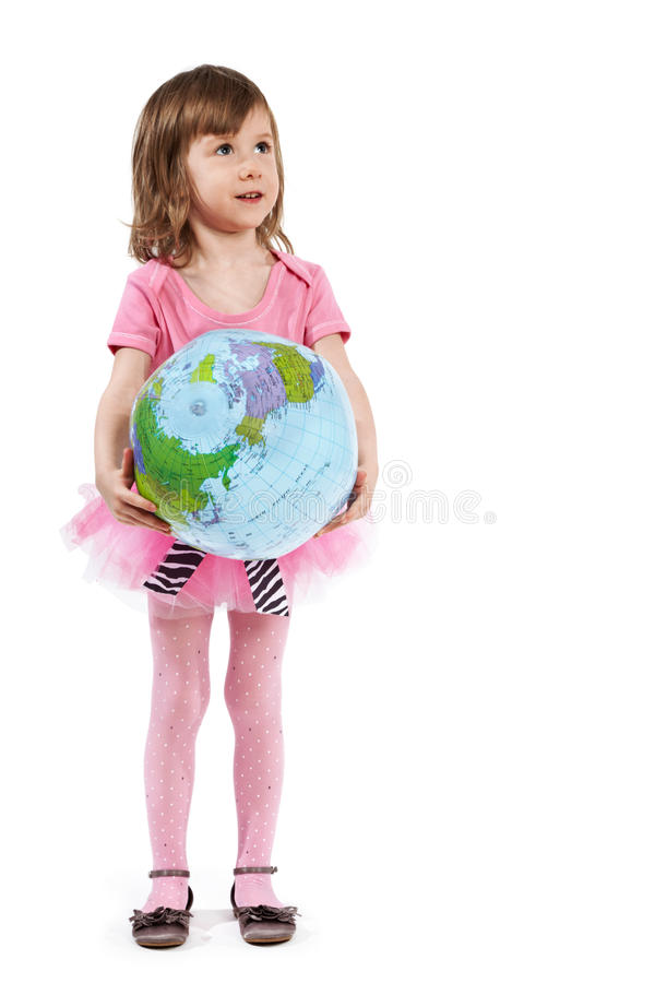Little girl with inflatable ball-globe. royalty free stock image