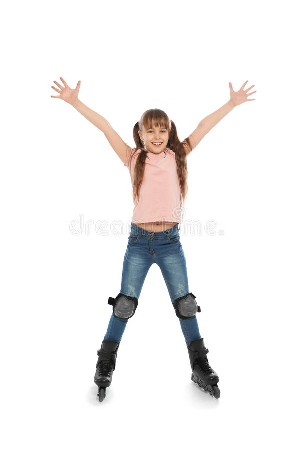 Little girl with inline roller skates. On white background royalty free stock images
