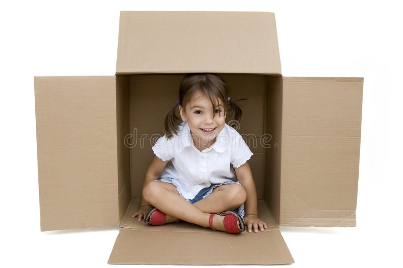 Little girl inside a Box. Isolated on white stock photography