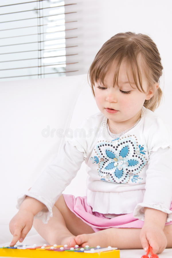 Little girl with instrument royalty free stock images