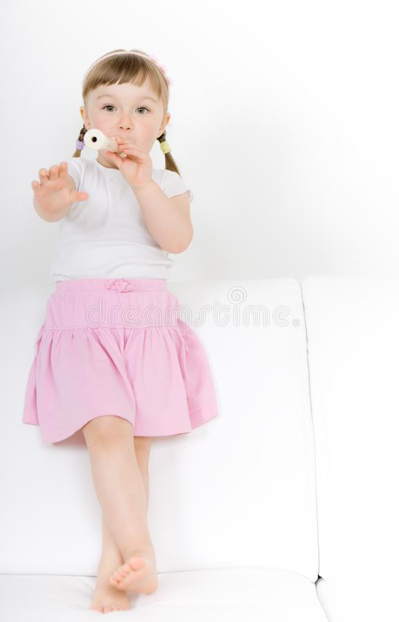Little girl with instrument royalty free stock photos