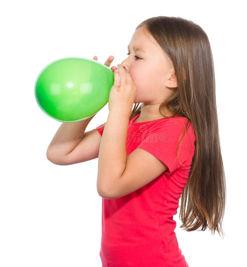 Free Little Girl Is Inflating Green Balloon Stock Photo - 32666170