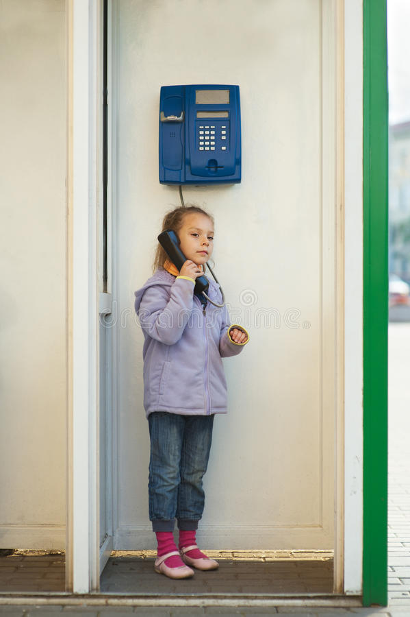 Little girl in jacket on landline royalty free stock images