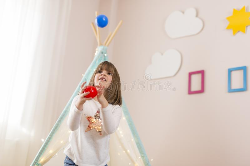 Little girl juggling royalty free stock photography