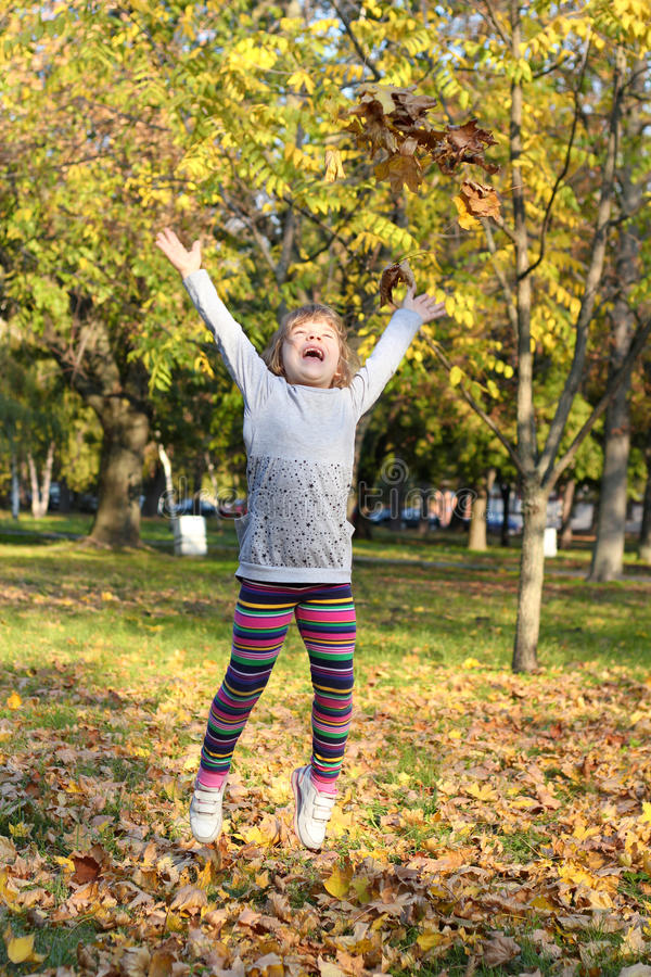Download Little girl jump stock image. Image of foliage, girl - 27669963