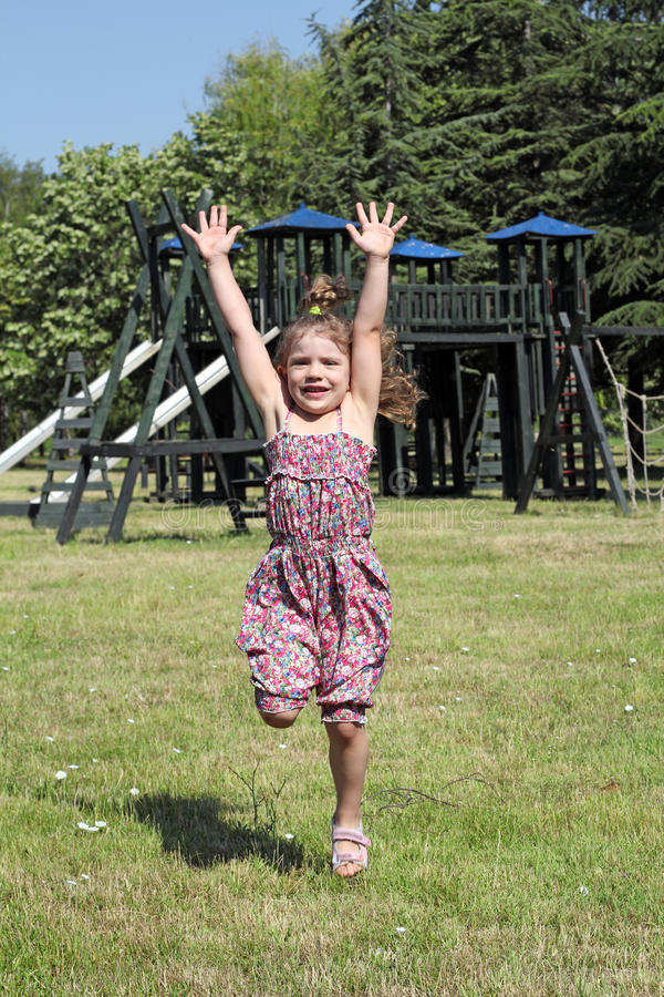 Download Little girl jumping stock image. Image of green, jumping - 25570887