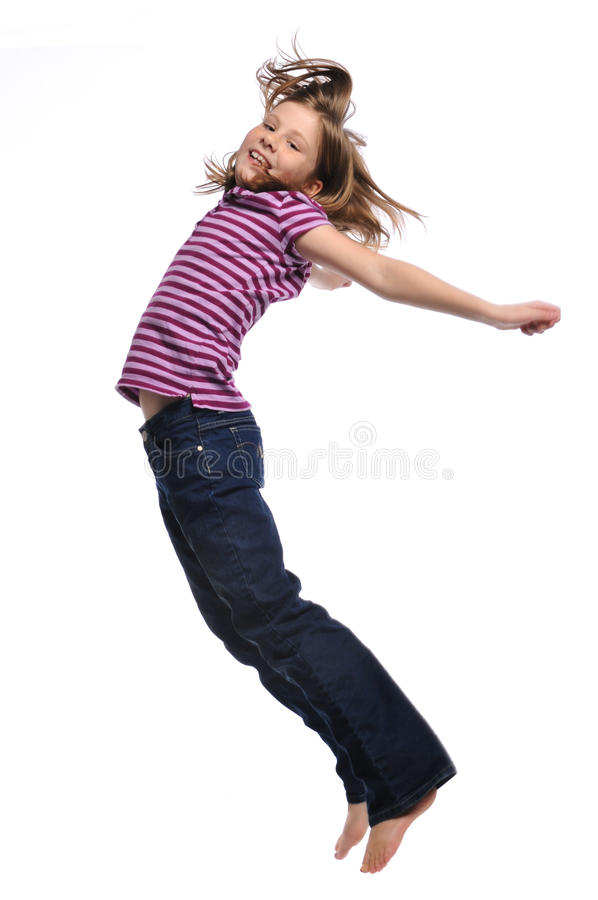 Little girl jumping and having fun royalty free stock image