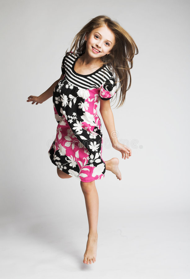Little Girl Jumping Of Joy Stock Photo