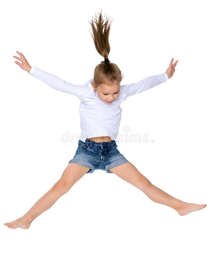 Little girl is jumping. stock photos