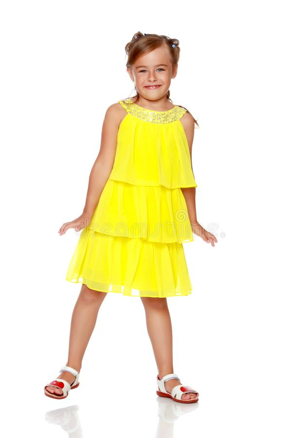 Little girl is jumping. stock photo