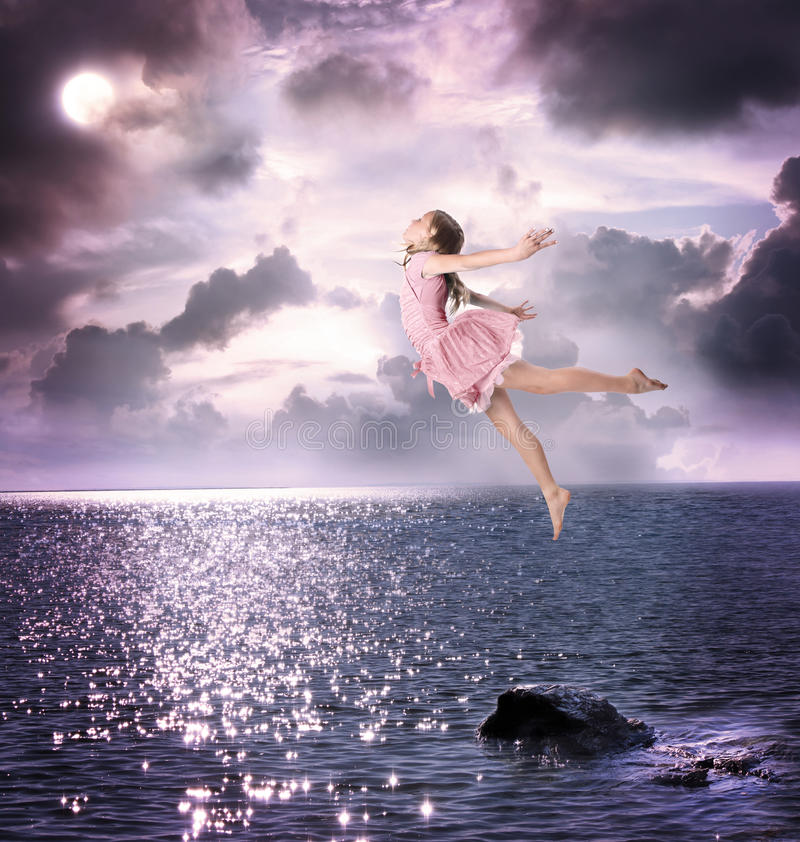 Download Little Girl Jumping Into The Night Sky Stock Photo - Image: 25908678
