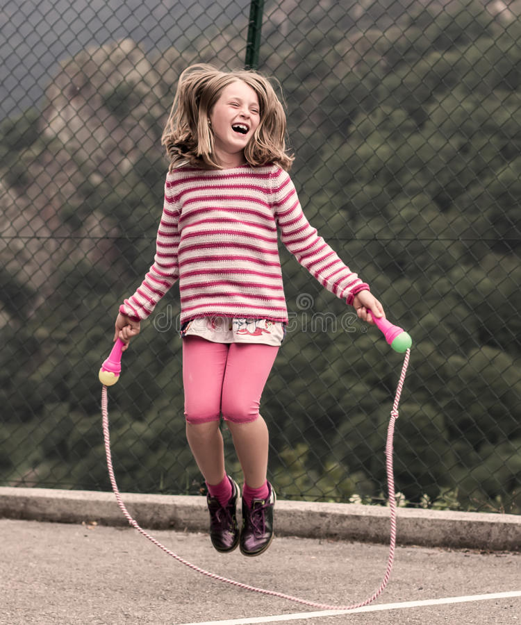 Little girl jumping rope stock photo
