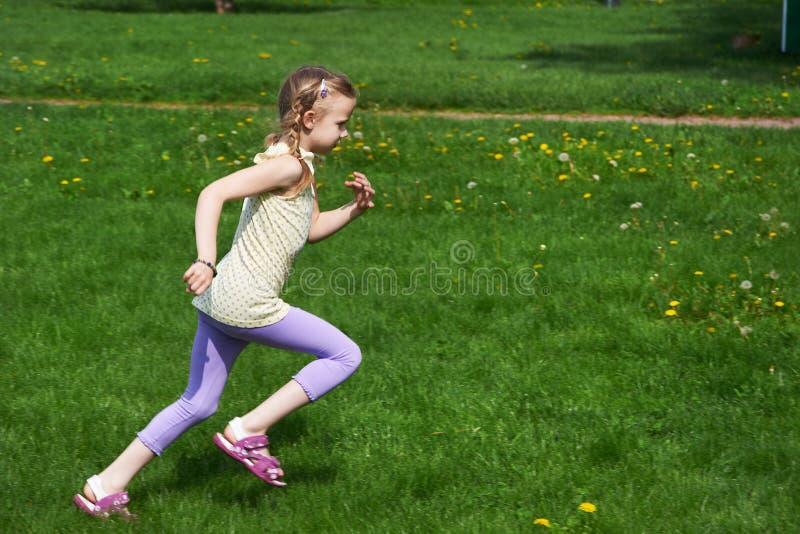 Little Girl Jumping, Running Stock Photo