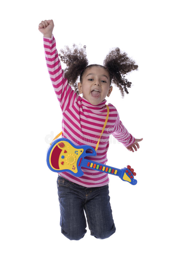 Little Girl Jumping With Toy Guitar Royalty Free Stock Photography