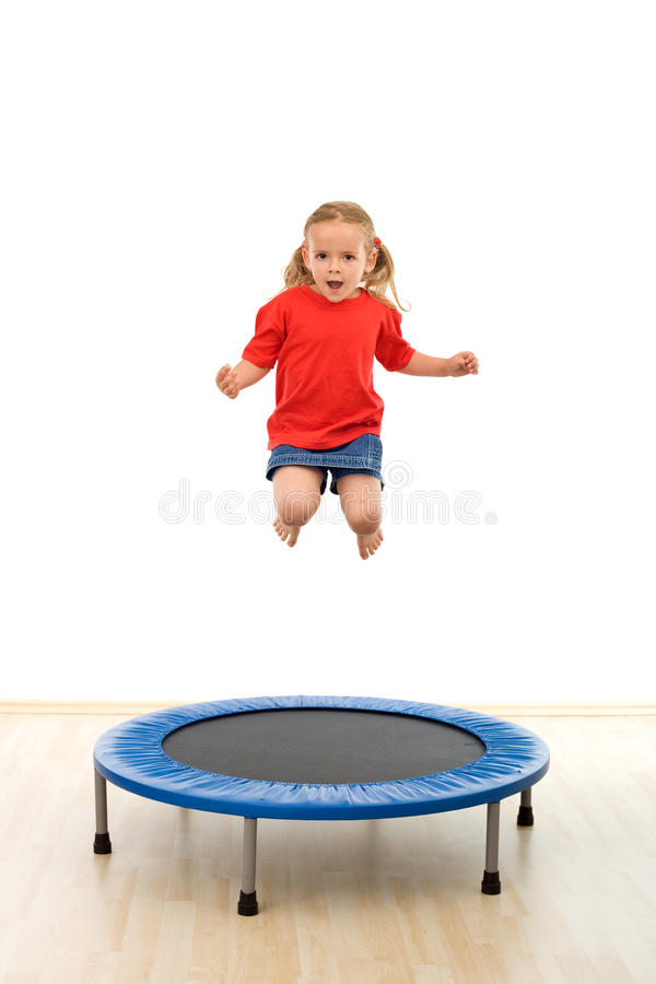 Little girl jumping on trampoline royalty free stock photo