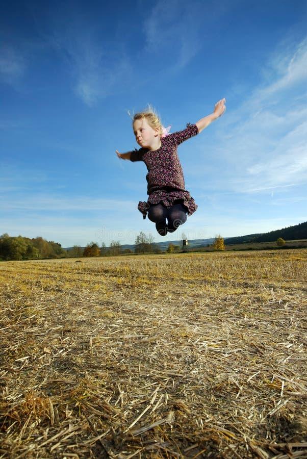 Little Girl Jumps Stock Photo