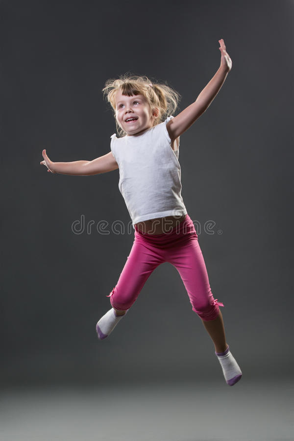 Little girl jumps stock images